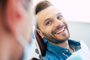 man happy with dental care