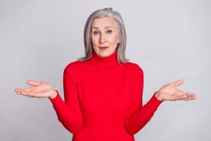 senior woman shrugs